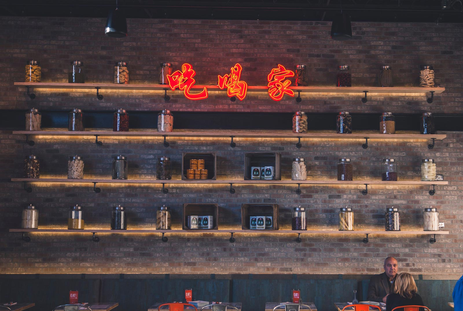 neon kanji and shelves